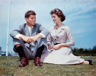 5570982-6333177-john_f_kennedy_and_jacqueline_sit_together_in_the_sunshine_at_ke-a-25_1540905184882